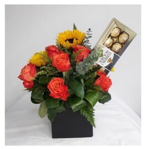 Box with roses, sunflowers and chocolates